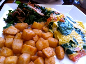 Spinach & tomato omelette with home fries